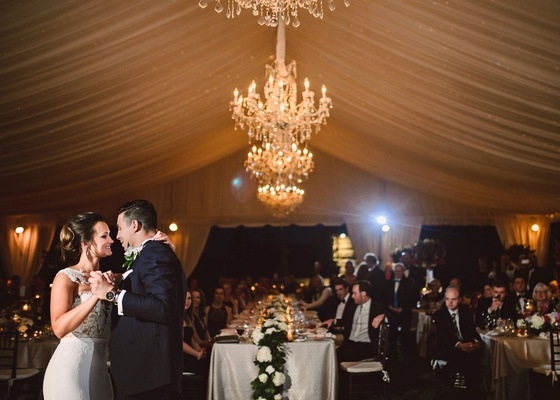 Wedding reception tent with crystal chandelier bride and groom first dance wedding ideas tent