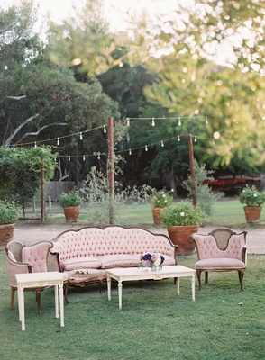 French vintage theme wedding with light pink antique furniture and coffee table at outdoor wedding