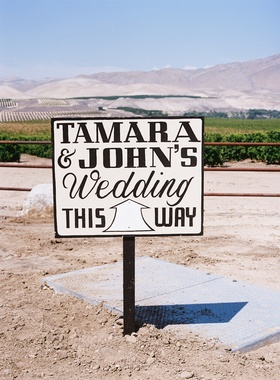 Black and white sign at ranch wedding in California