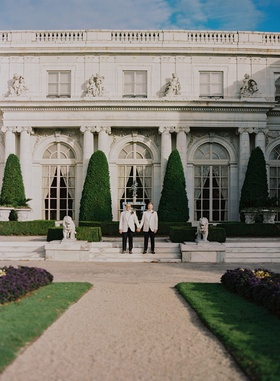 lgbtq gay same sex wedding couple white tuxedo in front of rosecliff mansion in newport rhode islan