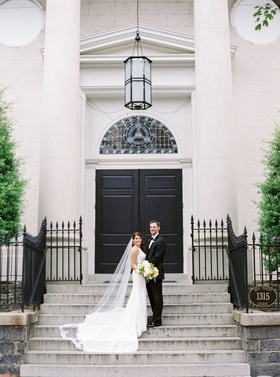 Wedding ceremony church venue bride in wedding dress and cathedral Renee Pawele veil with groom tux