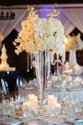 white orchids and roses on clear glass vase with cascading crystal strands