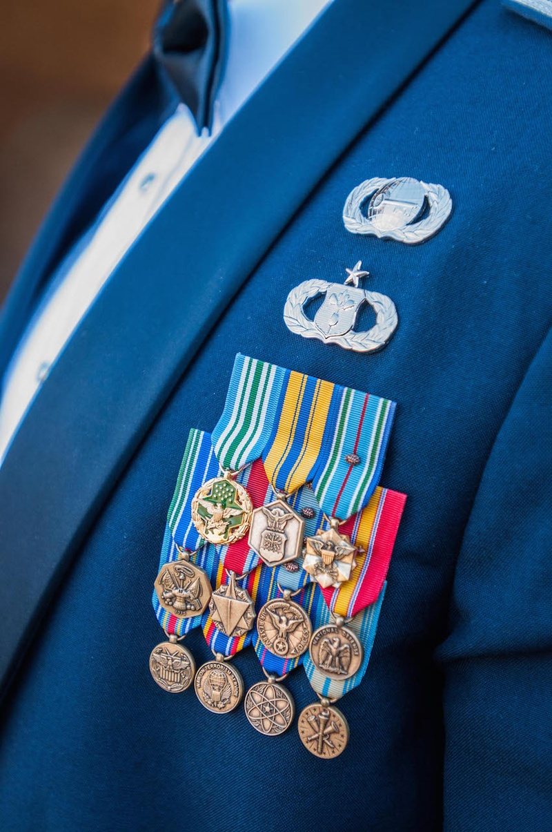 Groom with 11 military medals and two pins