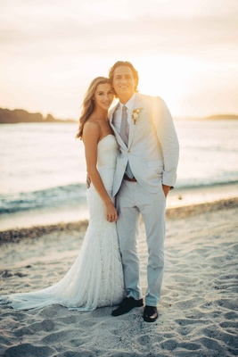 couple beach sunset mexico wedding destination gray blue suit Pacific Ocean sand