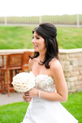 Bride with brown hair in Jackie O wedding hairstyle