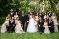 Bride in Monique Lhuillier wedding dress, groomsmen in tuxedos, bridesmaids in champagne dresses