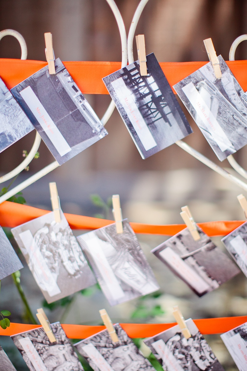 Seating card with pictures from travels on clothespins