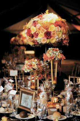 Reception table centerpiece in autumn colors and gold