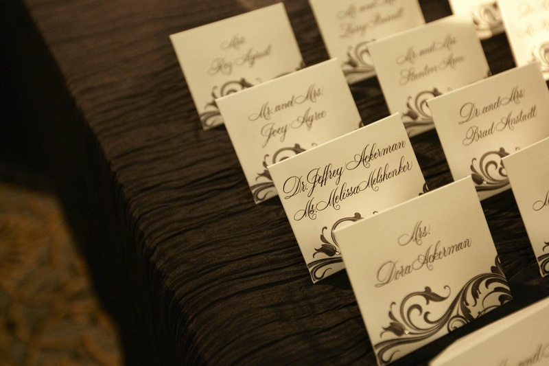Black and white escort cards with scroll pattern