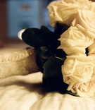 Ivory bridal bouquet wrapped in lace