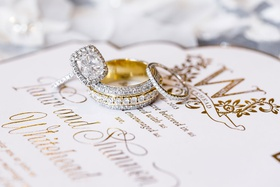 yellow gold wedding rings stack halo engagement ring sparkling on white gold wedding invitation