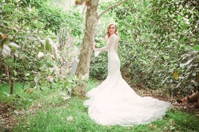 Bride in a Pronovias lace fit-and-flare gown with long sleeves, tulle train, Eden Gardens, CA