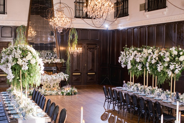 ebell long beach wedding, long tables with tall centerpieces with greenery and white orchids