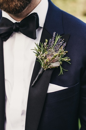 groom's boutonniere featuring a succulent accented with rosemary and lavender blooms