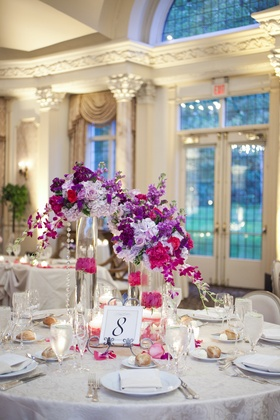 Wedding reception at the grand ballroom of Pleasantdale Chateau with table number on metal curved ea