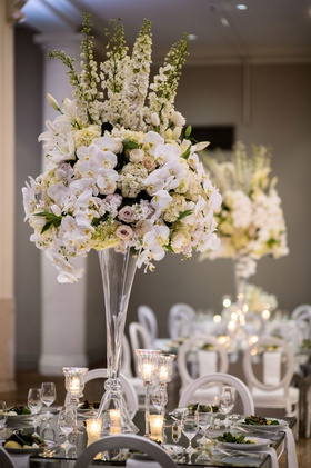 wedding reception centerpiece tall mirror table orchid purple lavender rose hydrangea lily flowers