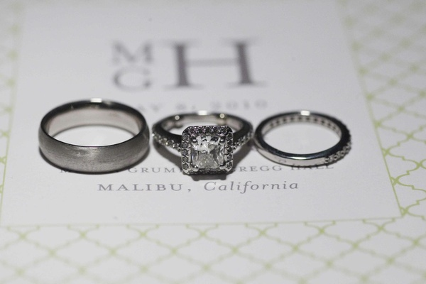 Bride and groom's engagement ring and bands