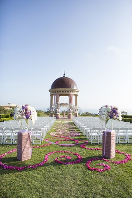 Pink and purple flower petals on grass aisle