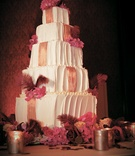 Five layer white cake with golden ribbon