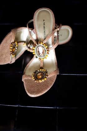 Pink strappy heels with beaded emblems