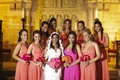 African American bridesmaids and hot pink maid of honor dress