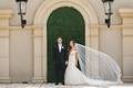 bride in stella york lace mermaid gown, cathedral veil with lace, groom in suit