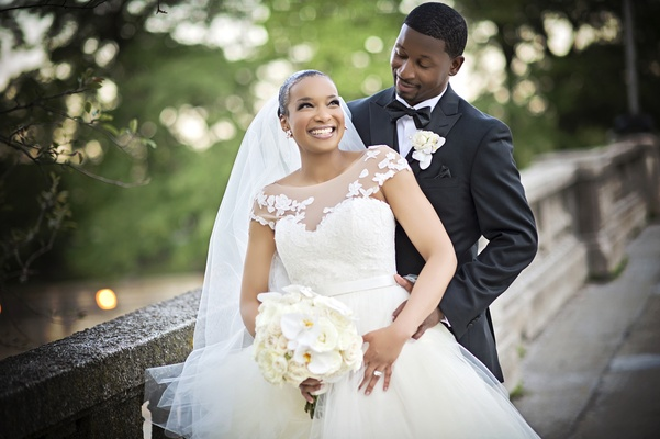 bride in legends romona keveza gown with illusion neckline, groom in jos. a. bank tux