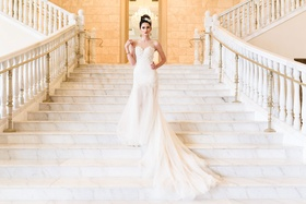 brides by nona wedding dress with long train, illusion neckline, lace applique