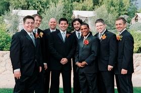 groomsmen wearing blue ties and orange boutonniers