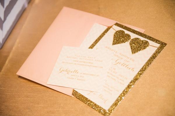 wedding shower invitation with pastel pink envelope golden glitter border hearts chevron design