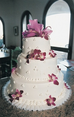 Three layer white wedding confection with fresh orchids