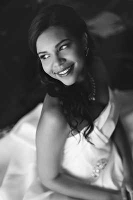 Black and white photo of African American bride in strapless Vera Wang wedding dress