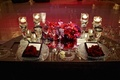 Bold red and purple flower centerpiece on couple's table