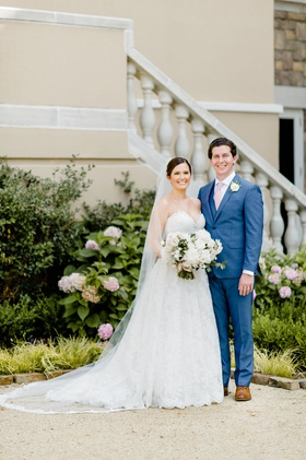 bride in strapless romona keveza wedding dress updo veil groom in blue suit vest pink tie brown shoe