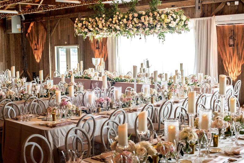 rustic-chic barn wedding reception with blush feminine touches