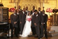 Bride and groom with groomsmen at African American wedding