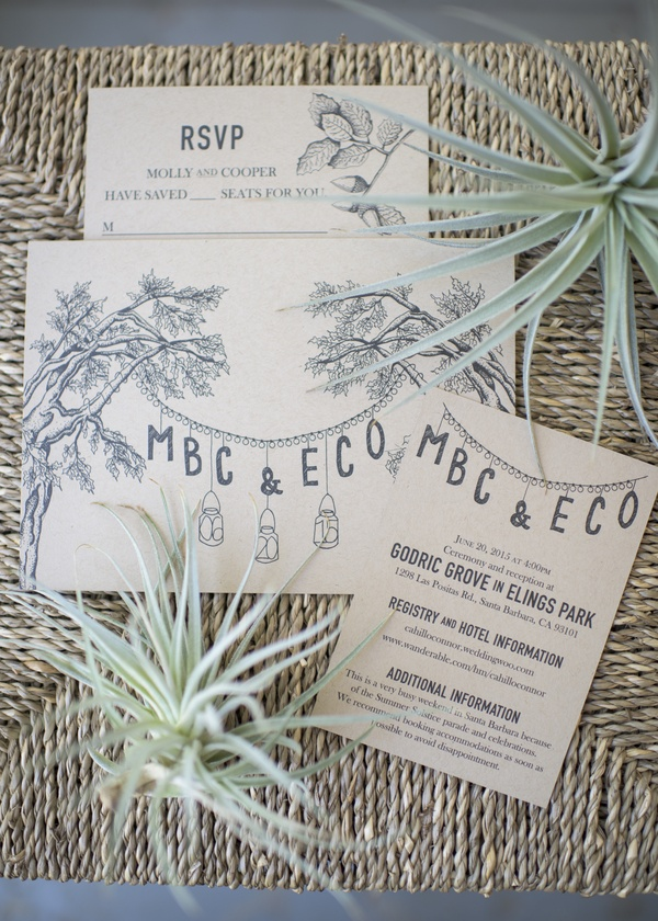 rustic wedding invitations natural organic with green leaf decorations on woven burlap mat