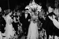 black and white photo of bride and groom after outdoor wedding ceremony beverly hills jewish wedding