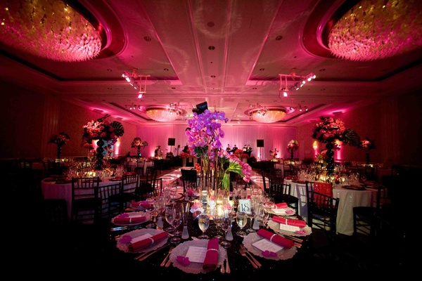 Wedding reception with black details and pink lighting