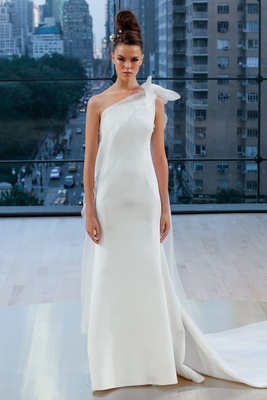 """Mercer"" Ines Di Santo fall 2018 one shoulder wedding dress sheath bow detail at shoulder cape"