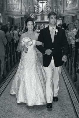 Black and white photo of couple exiting church