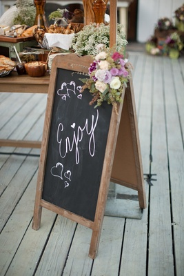 Standing wood sign with chalkboard letters