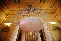 Winter wedding chuppah with suspended roses
