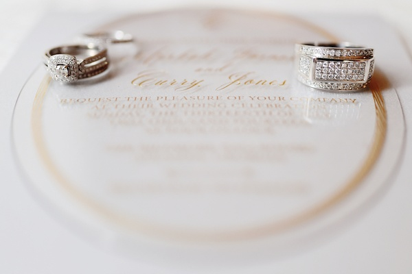 Vintage-inspired engagement ring and men's wedding ring with diamonds