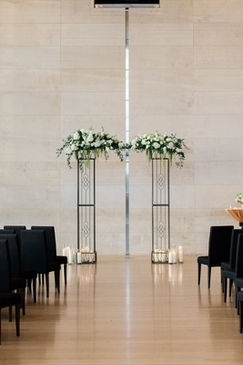 wedding at clinton presidential library, iron arch with white flowers and greenery