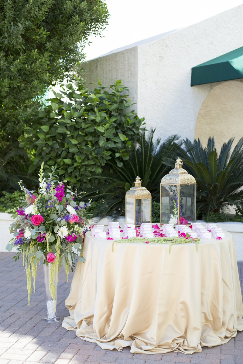 south asian wedding inspiration, escort card table with lanterns, floral display next to table