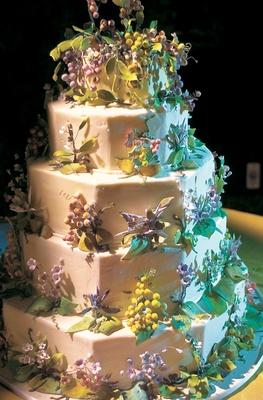Wine country wedding cake with grapes, leaves, vines, and purple flowers
