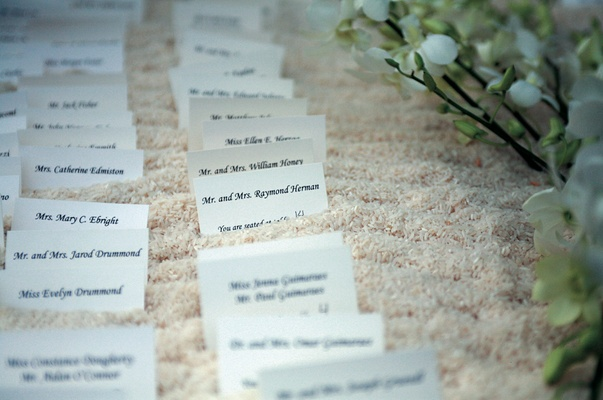 rows of place cards surrounded by flowers