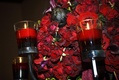 Wedding reception centerpiece of black Baccara roses and red floating candles