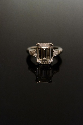 Emerald-cut engagement ring with side stones